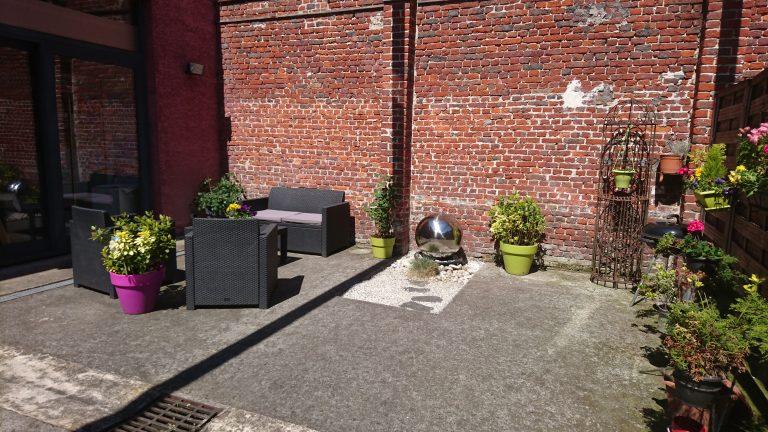 Espace détente la terrasse fontaine et salon